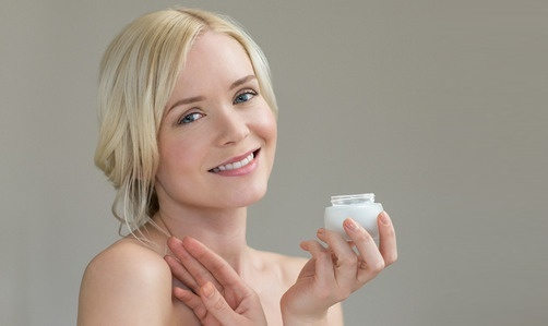 Woman with Moisturizer